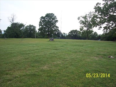 Highest Point in Benton County Arkansas, by MountainWoods. This shot is for perspective when you visit.  We are looking southwest.  Note the stumps for reference.  The highest point is to the right before getting to the low stump remains, above the 23 in the date stamp on the photo.