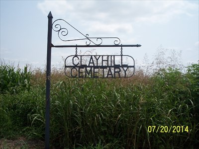 Clay Hill Cemetery, by MountainWoods.  This is the misspelled sign at the point given in the description where you turn off of FR1180 onto the cemetery lane - FR2027.