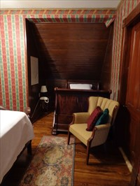 Shot inside The Romeo, showing its attic origins, covering a sleigh bed.