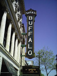 "The ""Shea's Buffalo"" vertical sign was put in place on August 9-12, 2004 on the front of the building on Main Street. Such blade signs were prominent on 1920- and 1930s-era movie palaces along Main Street."