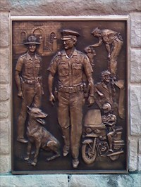 Police plaque from center of memorial.