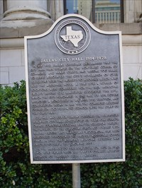This historic markers stands outside of the Dallas City Hall and briefly mentions the events of November 24, 1963