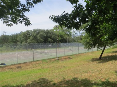 View from pathway on a hill overlooking the courts.