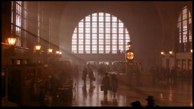 A distant view of Redford and Finnegan walking through Central Terminal.