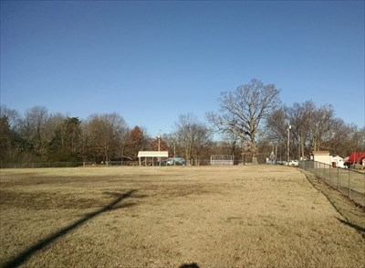 Ball Field at Seligman City Park, by MountainWoods.  Looking down the left field foul line toward home base and the back stop.  The playground, picnic area, other restrooms, and band gazebo are behind us.