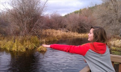My daughter throwing pellets into Crooked Creek