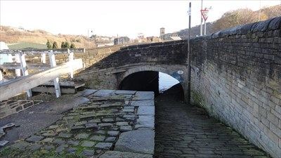 It can be seen descending down below the stone road bridge.