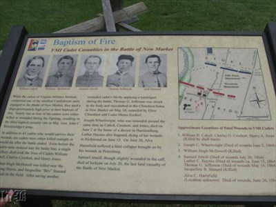 The historical sign shows old photos of some of the cadets who died and a map of the battlefield pinpointing the VMI casualties.