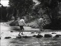 Image for Stepping Stones, Mill Bridge, N Yorks, UK – A Boy, A Girl, And A Bike (1949)