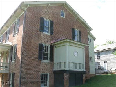 The CWDT marker is seen at far right behind the Shirley House.