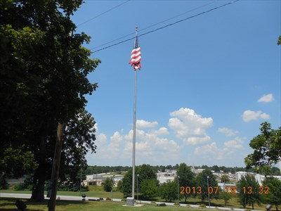 A view of the flag itself and the memorial at the base of its pole, by MountainWoods