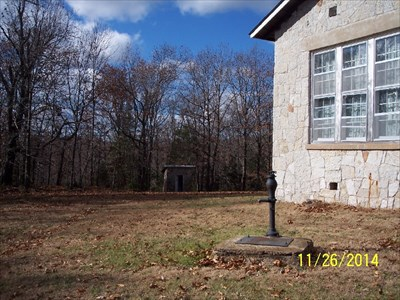 Outhouses at Vine Hill School/Church, by MountainWoods.  This context photo shows the privy for the women as seen from the left side of the building near the old hand-operated pump.  The privy for the men is about equidistant away to our left.