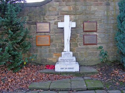 The plaque is sited to the lower right hand side of the central white memorial.