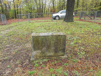 This is one of only 3 grave markers facing this way, and is the closest to the double gate; by MountainWoods.  The survey marker is indicated in this photo (light grey).