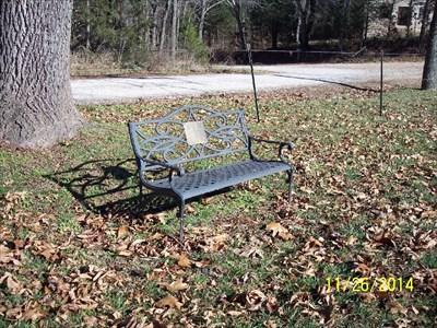 Virginia Ellen Harris Dedicated Bench, by MountainWoods.  This context photo shows the mysterious, abandoned, one-room Carney School in the background.  It is across from the cemetery entrance.