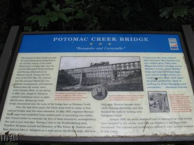 The sign stands in front of the abutment.