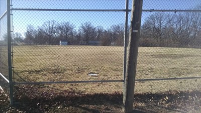 Ball Field at Seligman City Park, by MountainWoods. Looking through the back stop over home base and toward the rest of the park, to the south.