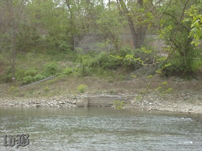 The old North Fork bridge embankment is seen on the south shore of the river.