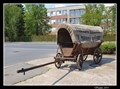 Image for Covered wagon in front of former coaching inn, Chrudim, Czech Republic