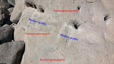comparison of ancient petroglyphs (not easily visible) and modern graffiti...