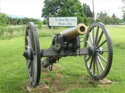 This cannon represents where Confederates had a 4-gun battery. The sign alerts travelers on nearby I-81 they are passing through the New Market Battlefield.