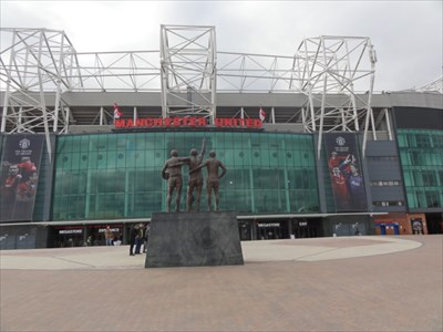 Facing the stadium is the 'United Trio' of George Best, Denis Law and Sir Bobby Charlton, 3 of the clubs famous players from the 1960s and 1970s
