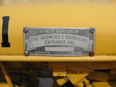 Dealer Plate on L side of engine cowling. Sold and Serviced by The Growers and Producers Exchange Roanoke, Virgina