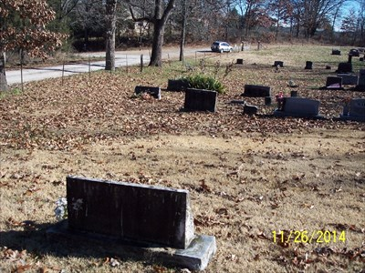 Homer E. Neely Centenarian Headstone, by MountainWoods.  This context shot shows the view from behind the headstone looking toward the entrance gate. The abandoned one-room school is visible in the upper left.