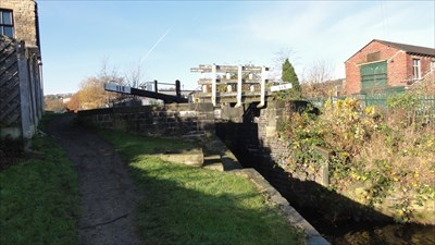 The integrated wooden footbridge can be seen in front of the lock gates.