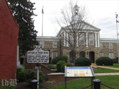 The CWDT marker stands next to a VA historical sign in front of the courthouse.