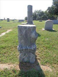 This Woodmen of the World monument was decapitated, so now, the top of it serves as a footstone.