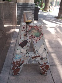 """""""22 benches throughout Downtown. Sides are """"A"""" shaped to denote """"A""""naheim. Real bits and pieces of Anaheim incorporated.""""  http://www.anaheim.net/com_dev/aipp/10a.htm"""