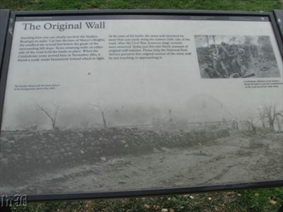 A historical marker shows an old photo of the Innis House as it sat along the stone wall on Sunken Road during the Battle of Fredericksburg.