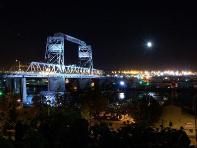 There are several flood lights that illuminate the south side of the bridge at night.