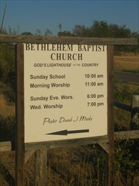 A sign to greet you as you travel towards the church via the county roads.