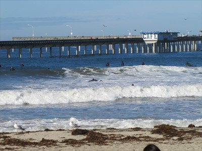 Cafe on Pier and Surfers, San Diego, CA