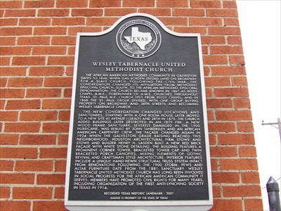 The marker text wouldn't fit in the long description:The African American Methodist community in Galveston dates to 1848, when Gail Borden deeded land on Broadway for a salve church. Following the Civil War, the congregation changed its affiliation from Methodist Episcopal Church, South, to the African Methodist Episcopal denomination. The church became known in 1867 as Reedy Chapel A.M.E., forerunner of A.M.E. churches throughout Texas. St. Paul M.E. Church split from Reedy Chapel, and in 1868 the St. Paul group divided, with one group buying property on Broadway and 38th Streets and becoming Wesley Tabernacle Church.The new congregation changed locations and sanctuaries, starting with a one-room house later moved to a new site at Avenue I (Sealy) and 28th in 1870. The church added buildings later destroyed in an 1879 fire. A new wood frame sanctuary, severely damaged in the 1900 hurricane, was rebuilt by John Tankersley and an African American carpentry crew. The façade changed again in 1924 when the Galveston grade raising reached this neighborhood. Houston architectural firm Stowe and Stowe and builder Henry H. Lasden built a new red brick facade with white stone detailing. The building features a prominent corner tower, bracketed tower cap and twin bracketed porch canopies, mixing elements of Gothic Revival and Craftsman style architecture. Interior features include a unique hand-hewn structural truss system intact from renovations following the 1900 storm. Pews and altar furniture date from the 1881 sanctuary. Wesley Tabernacle United Methodist Church has long been involved in social progress for the African American community it serves. Members have promoted civil rights for many years, including organization of the first anti-lynching society in Texas in 1914.Recorded Texas Historic Landmark - 2007Marker is Property of the State of Texas