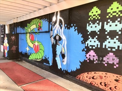 Classic arcade game mural by Sam O. White at the entrance