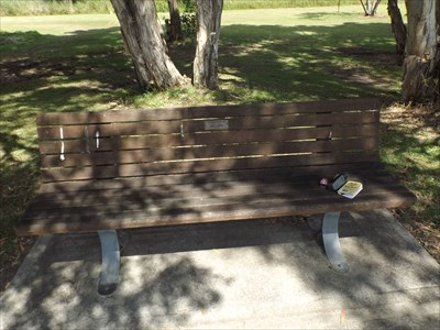 The bench where his plaque is placed at Laurieton.
