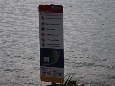The council sign, with warnings, for Front Beach.