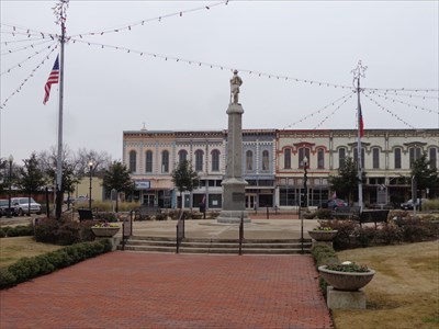 Shot of the statue and square during the Christmas holidays, with lights.