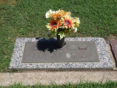 Mr. Taylor shares a headstone with his wife, Helen.