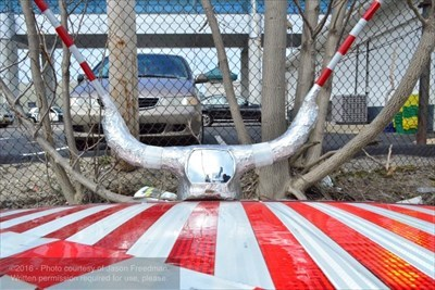 PogoDave's Candy Cane Car is covered in reflective red and white tape and an assortment of absurd additions in the name of nonsense, silliness, and laughter.