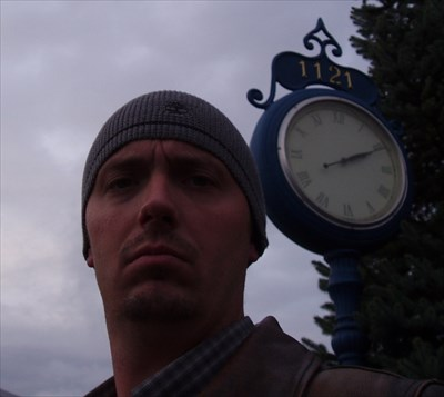 I managed to snap this photo of myself in front of the clock.