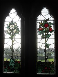 ...a delightful modern, floral window in the south aisle.