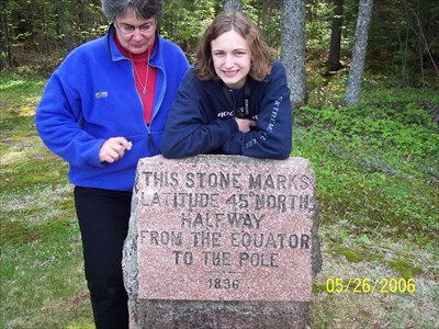 Here is my wife and our oldest daugther on her last vacation trip with us before moving out on her own, at the 45th Parallel Marker, by MountainWoods
