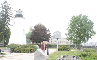 geotrooperz-pp at the Havre de Grace -- War of 1812 historical marker with Concord Point Light House in the background.