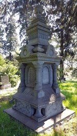 This zinc headstone stands at least 10 feet tall.