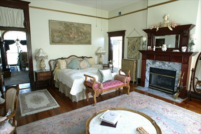 King Bed, with fireplace and heart-shaped whirlpool for two.