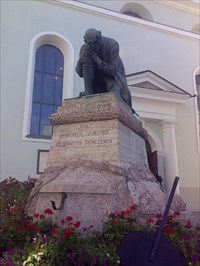 the statue in front of the church